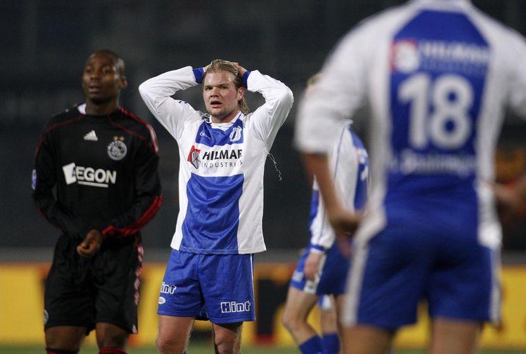 Herre Huberts (M) van WHC baalt na de 0-5 van Ajax. Links: Enyong Enoh. Foto ANP Beeld
