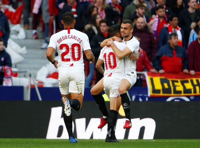 Soccer Football - La Liga Santander - Atletico Madrid v Sevilla - Wanda Metropolitano, Madrid, Spain - March 7, 2020  Sevilla's Joan Jordan and Ever Banega celebrate after Luuk de Jong (not pictured) scores their first goal   REUTERS/Stringer