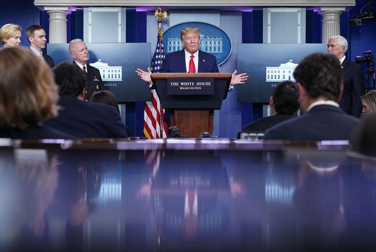 President Donald Trump tijdens zijn dagelijkse persbriefing in het Witte Huis. Beeld AFP