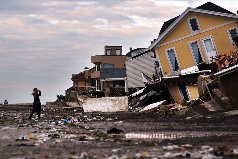 De New Yorkse wijk  Queens in 2012 na superstorm  Sandy.  Beeld AFP