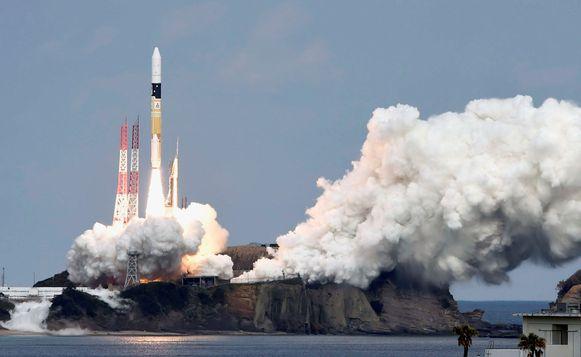 De lancering van de raket die de Hayabusa-2 draagt in december 2014.