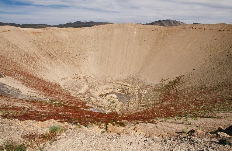 De krater die achterbleef na een kernproef in Nevada. Beeld Corbis via Getty Images