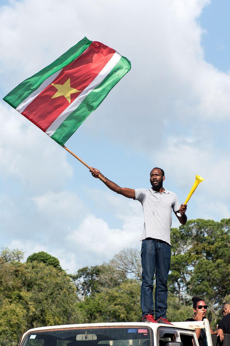 Curtis Hofwijks tijdens een manifestatie in Paramaribo. Beeld Pieter Van Maele