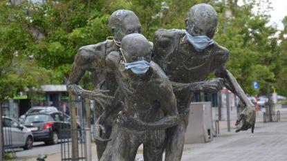 Ninoofse standbeelden krijgen mondmasker aangemeten door streetartkunstenaar Myra