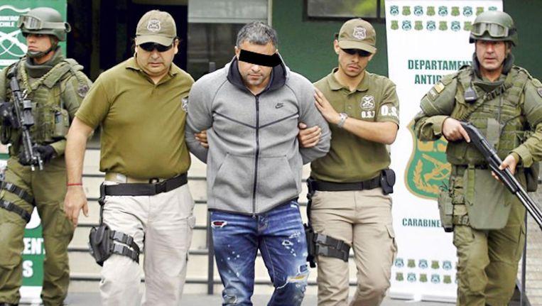 'Rico de Chileen' wordt in oktober 2017 in Chili opgepakt in de garage van een hotel waar hij verbleef met zijn Colombiaanse vriendin. Beeld anp