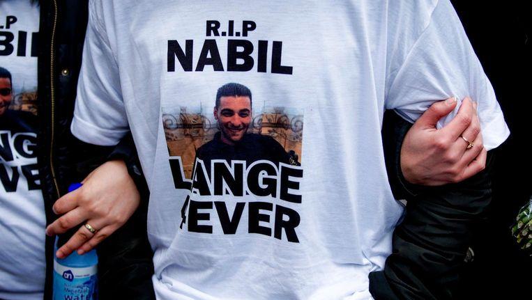 Deelnemers aan een stille tocht voor de vermoorde 23-jarige Nabil Amzieb. Beeld anp