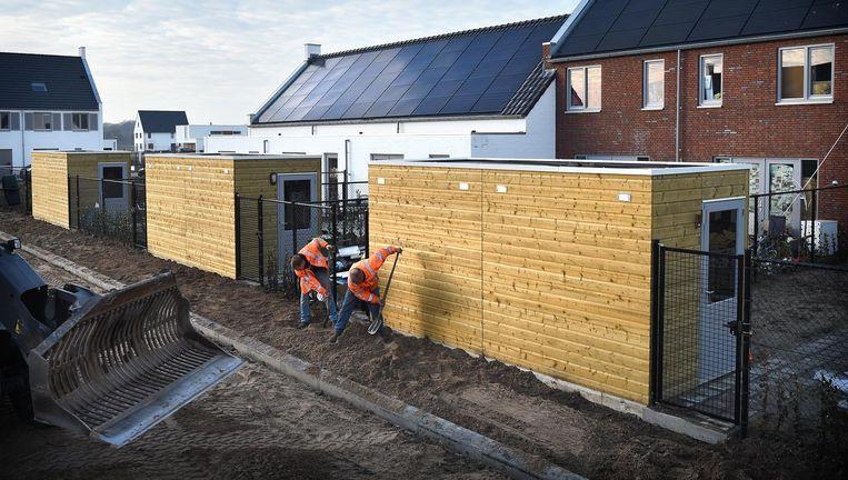 W ie een nieuw, energiezuinig huis koopt, heeft daar binnenkort op drie niveaus plezier van. Beeld Marcel van den Bergh