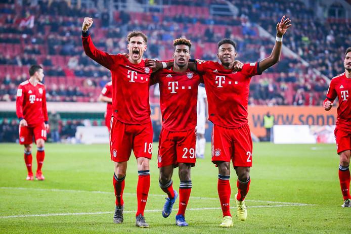 Leon Goretzka, Kingsley Coman en David Alaba juichen na de 2-3 voor Bayern München.