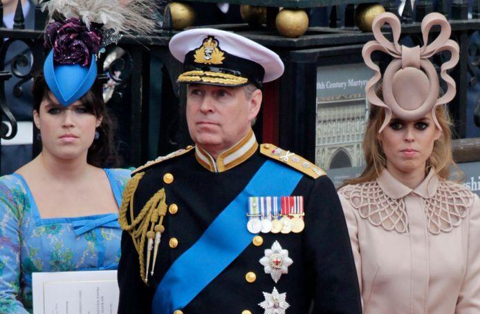 Prins Andrew met z'n dochters Beatrice en Eugenie.