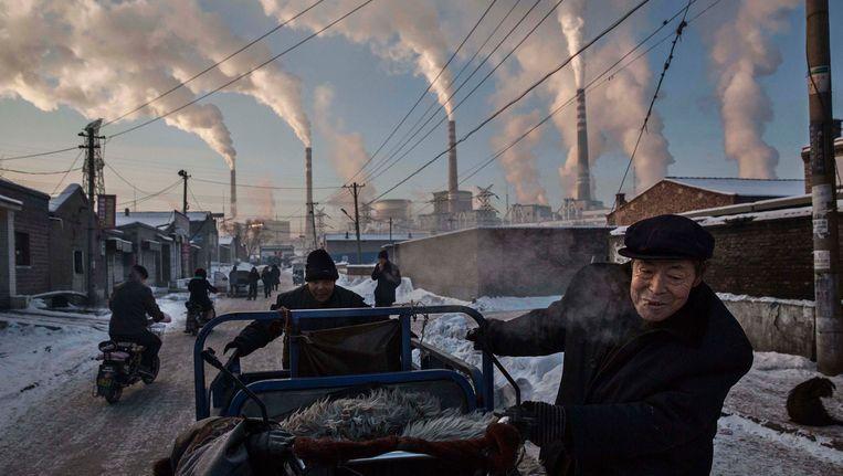 Winnende World Press Foto in de categorie 'Dagelijks Leven', getiteld 'China's kolenverslaving'. Beeld AP