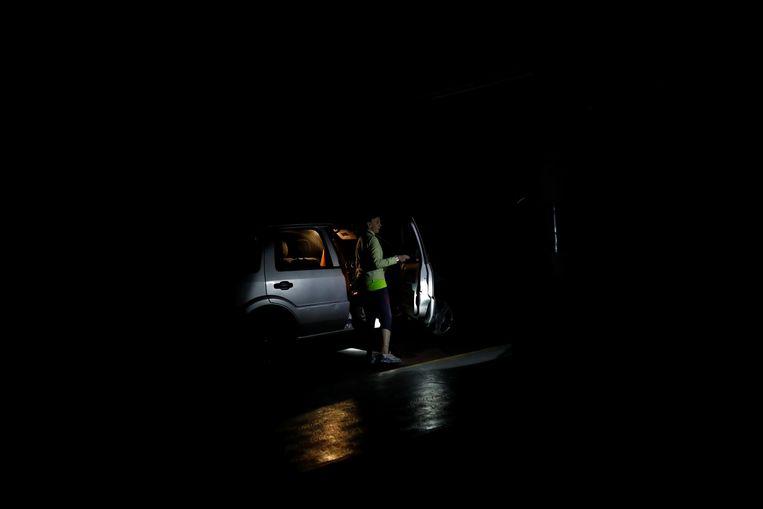 Een donkere parkeergarage in Caracas. Beeld REUTERS