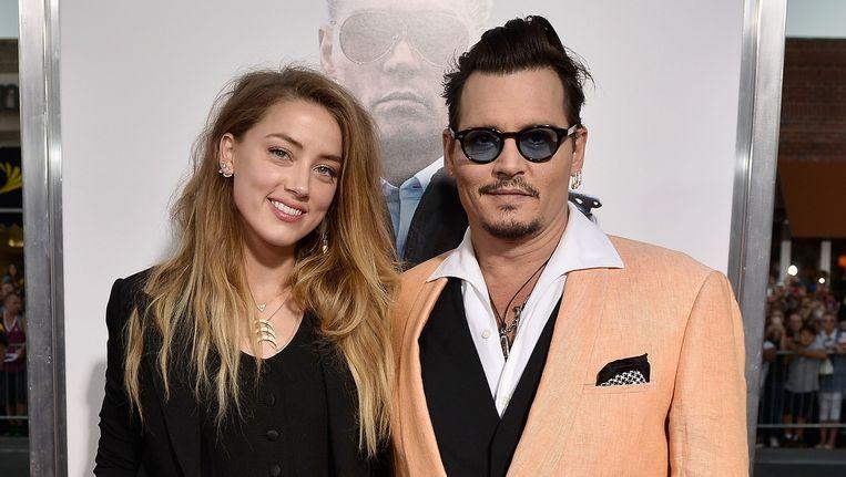 Actrice Amber Heard en acteur Johnny Depp. Beeld Getty Images