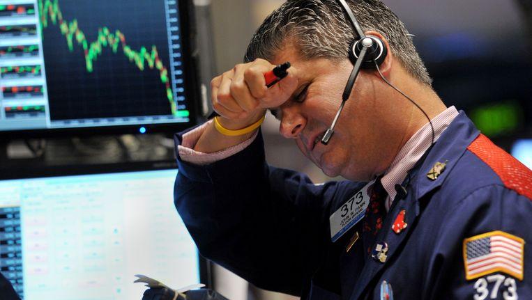 Een handelaar op de New York Stock Exchange op donderdag. Beeld AFP