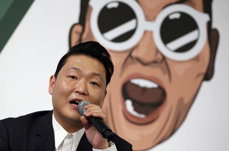 Psy tijdens de presentatie van zijn nieuwe album, gisteren in Seoul. Beeld ap
