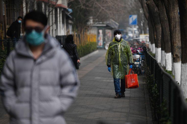 Man draagt beschermende kledij, Peking