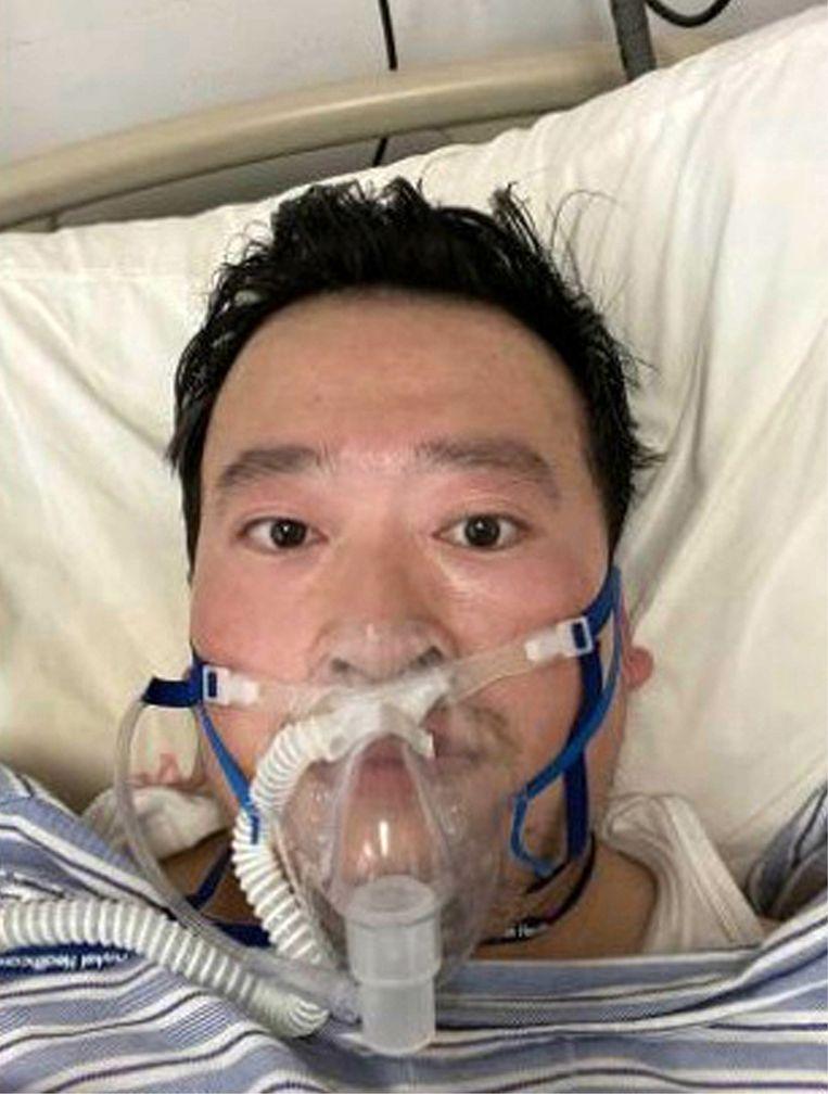 Oogarts Li Wenliang waarschuwde als eerste voor het virus, maar werd gearresteerd. Intussen is hij overleden. Beeld