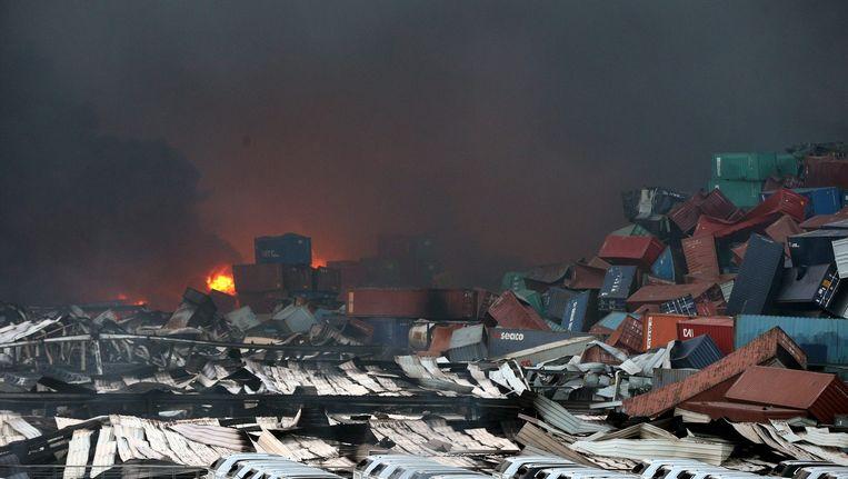 De ravage na de ontploffing in Tianjin. Beeld null