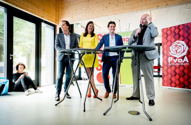 Laurens Ivens (SP), Marjolein Moorman (PvdA), Reinier van Dantzig (D66) en Rutger Groot Wassink (GroenLinks) bij de perspresentatie van het Amsterdamse coalitieakkoord Beeld anp