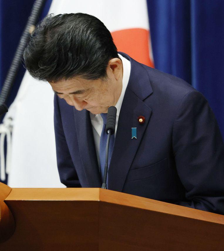 Premier Shinzo Abe tijdens de persconferentie waarin hij zijn afscheid aankondigt. Beeld Kyodo News / Getty