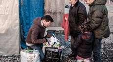 fotoreeks over Vluchtelingen in Duinkerke proberen te overleven in de vrieskou