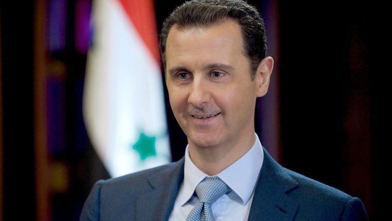 Een glunderende Assad in een interview met de BBC, foto 10 februari 2015.