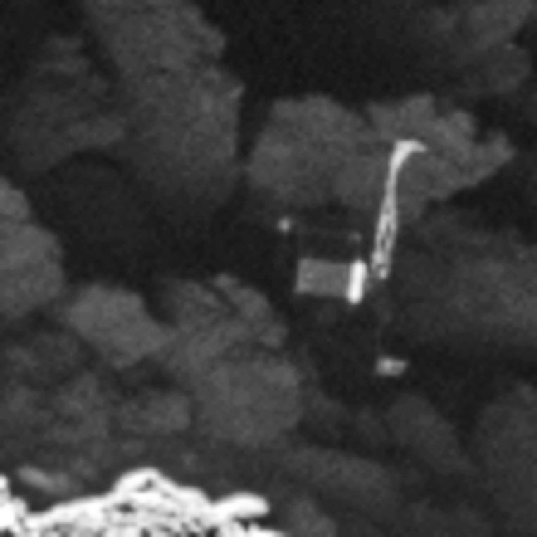 Komeetlander Philae gezien door de camera van moederschip Rosetta, op een afstand van 2,7 kilometer. Beeld ap
