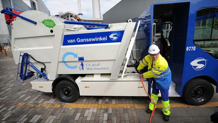Een elektrische vuilniswagen van Van Gansewinkel. Beeld Marcel van den Bergh