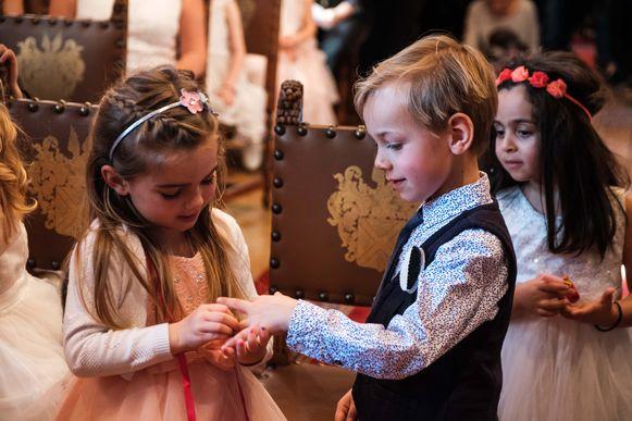 2019/02/14, Wijnegem, Belgium. Kinderhuwelijken in het kader van Valentijn. In picture: Bo gaf zonet haar ja-woord aan Arthur en geeft hem zijn ring.