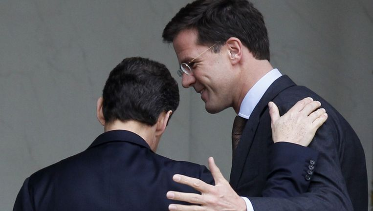 Premier Mark Rutte begroet de Franse president Sarkozy. Beeld ap