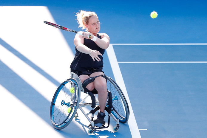 MELBOURNE, AUSTRALIA - JANUARY 23:  Aniek Van Koot of the Netherlands plays a backhand in her Women's Wheelchair Singles quarter final match against Kgothatso Montjane of South Africa during day 10 of the 2019 Australian Open at Melbourne Park on January 23, 2019 in Melbourne, Australia.  (Photo by Darrian Traynor/Getty Images)