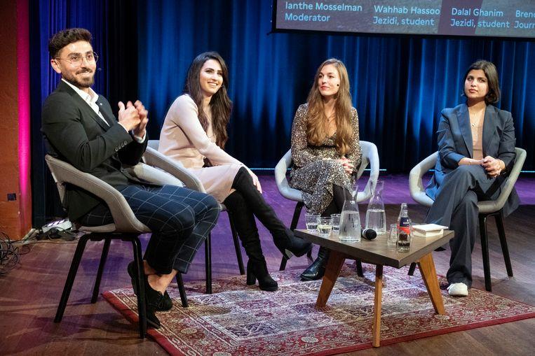 De Amsterdamse yezidi Wahhab Hassoo, links, tijdens een debat in De Balie. Beeld Jan Boeve, HH