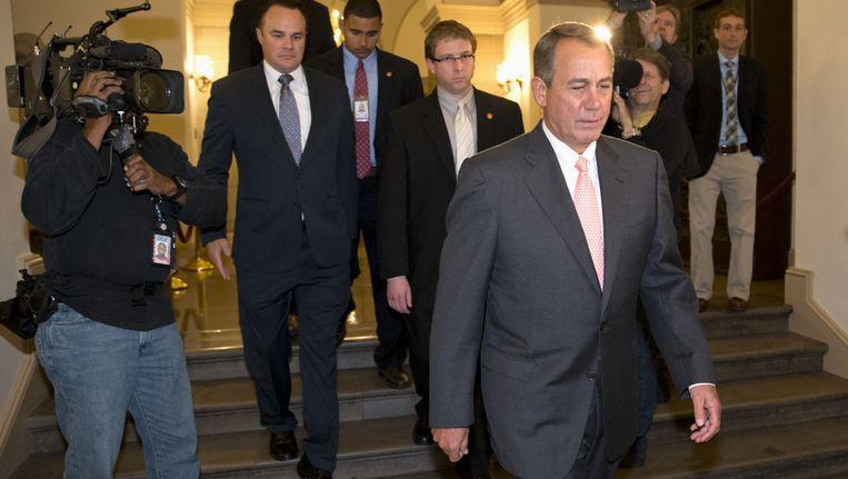 John Boehner op weg naar president Barack Obama in het Witte Huis. Beeld ap