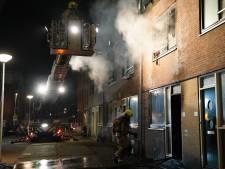 Vlammen slaan uit woning, evacuatie bewoners en buren