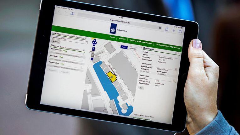 De website van het WOZ-waardeloket op een iPad. Met het loket kunnen burgers online de WOZ-waarde van woningen raadplegen. Beeld anp