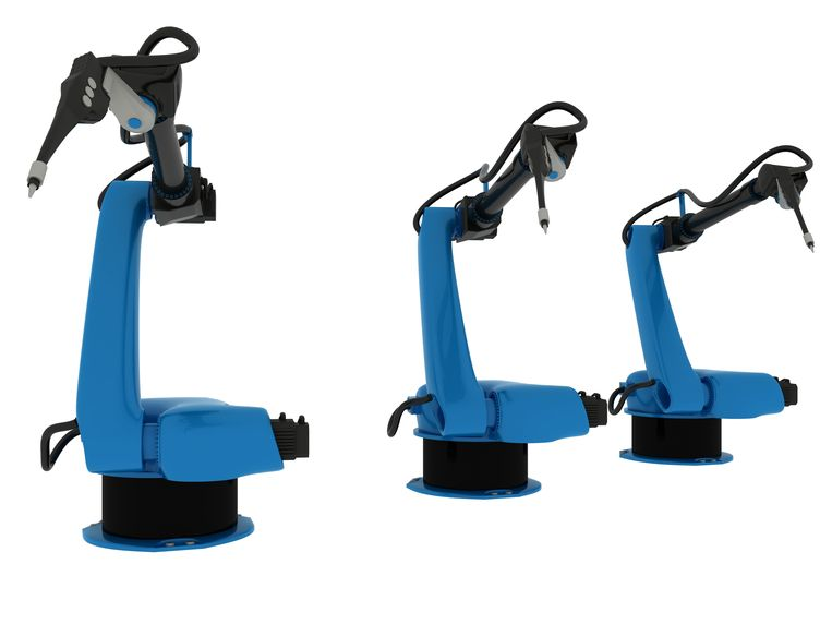 Industriële robotarmen. Beeld Colourbox