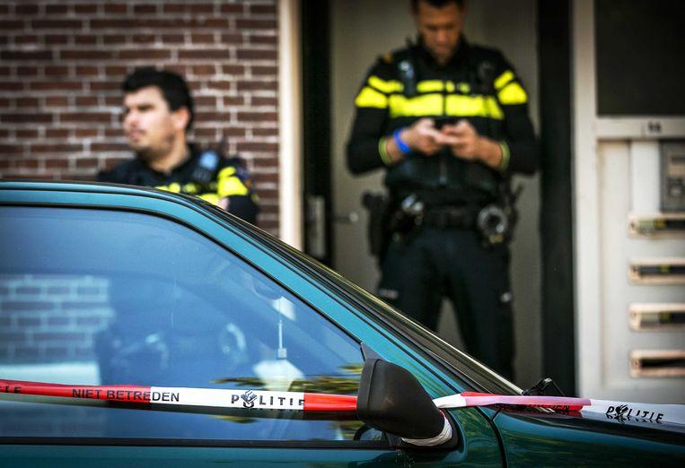 Politie bij de vermoedelijke woning van Thijs H. in Den Haag. Beeld ANP