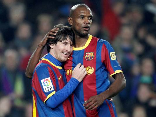 Messi en Eric Abidal.