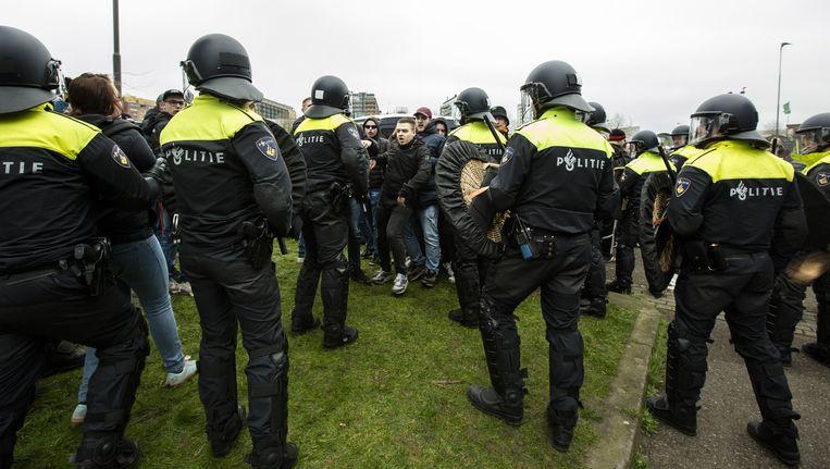 De politie zal zoveel mogelijk direct en zichtbaar optreden bij strafbare uitingen. Beeld ANP