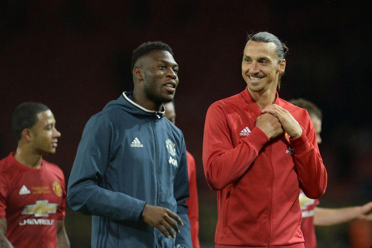 Timothy Fosu-Mensah (L) en teamgenoot Zlatan Ibrahimovic. Beeld afp