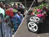 Milieubeweging rouwt met 'begrafenisstoet' om klimaat