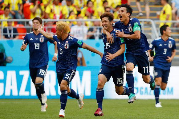 Japan viert de winninggoal van Osako.