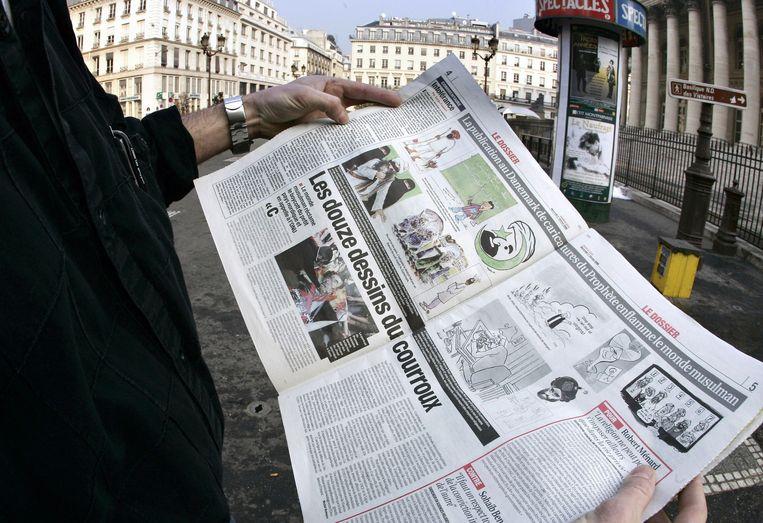 De omstreden Deense cartoons in een Franse krant, in februari 2006. Beeld afp