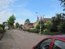 Vlaggen in Velddriel als aankondiging 125-jarig jubileum fanfare la Harpe