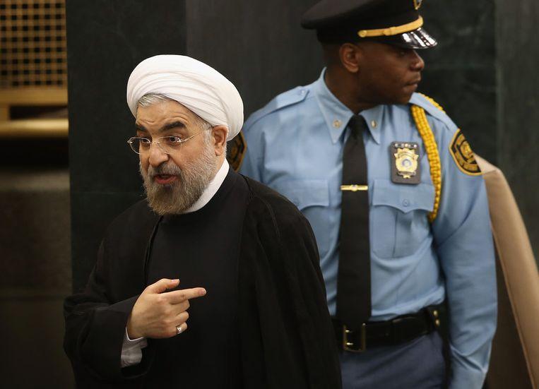 President Rohani dinsdag bij het verlaten van het spreekgestoelte. Beeld afp