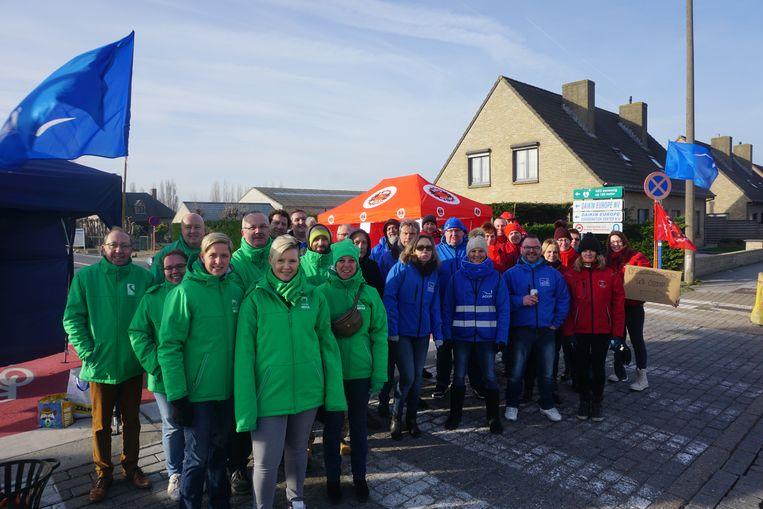 De vakbonden ACV, ACLVB en ABVV voeren samen actie aan de poorten van Daikin.