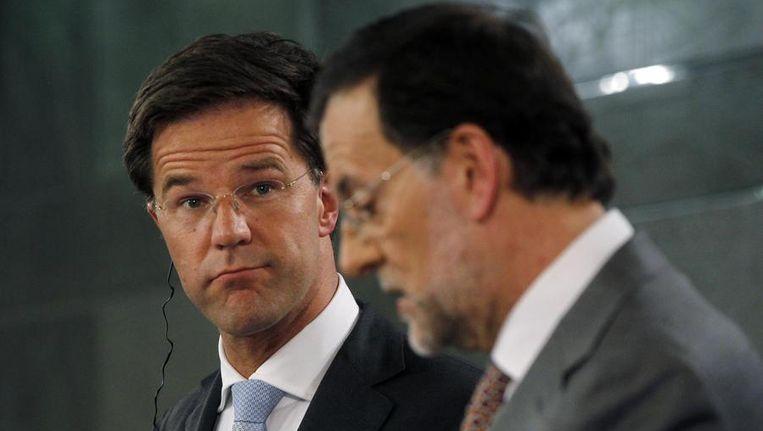 Demissionair premier Rutte (links) en zijn Spaanse ambtsgenoot Rajoy, vorige week in Spanje. Beeld reuters