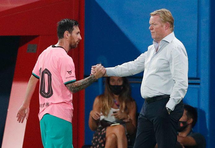 Ronald Koeman en Lionel Messi.