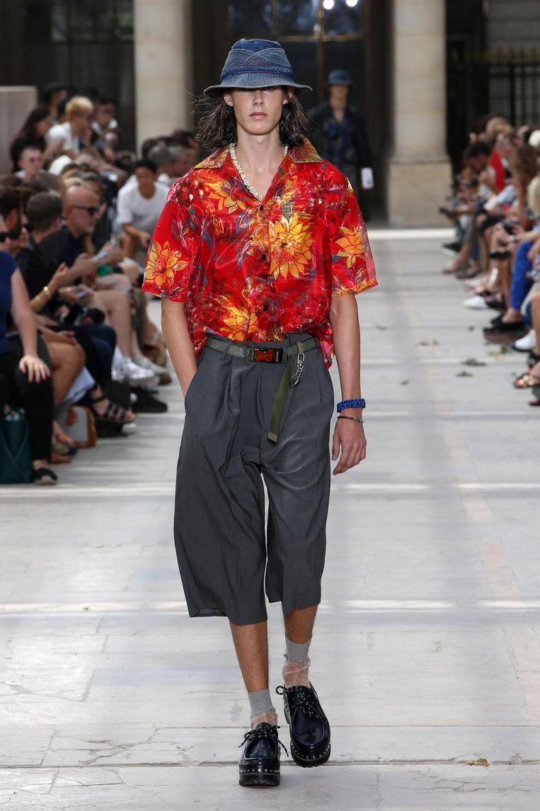 Aantrekkelijk duffe schoenen, heel opmerkelijke sokken bij Louis Vuitton. Beeld null