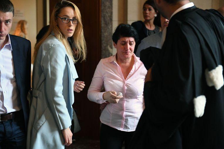 De familie van de slachtoffers tussen de advocaten bij het proces twee jaar geleden.