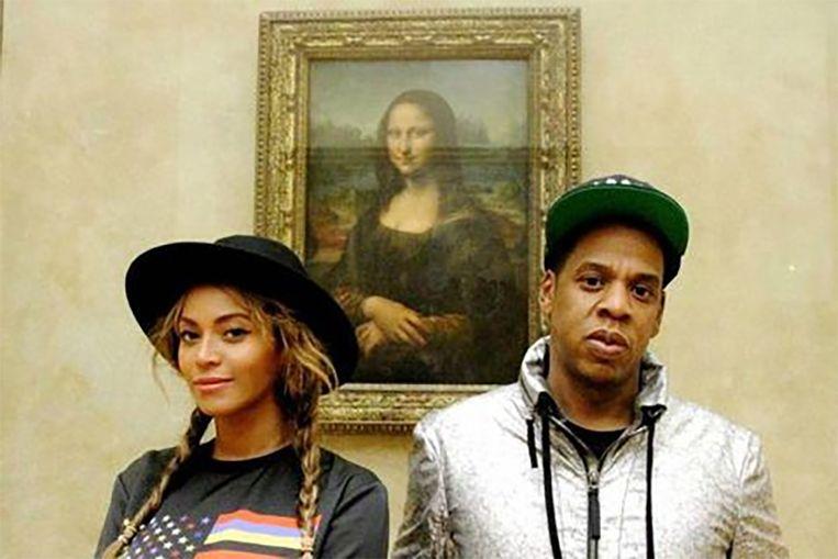 Beyoncé en Jay Z bij de Mona Lisa. De kans is klein dat een gewone sterveling een gelijkaardig kiekje kan nemen.